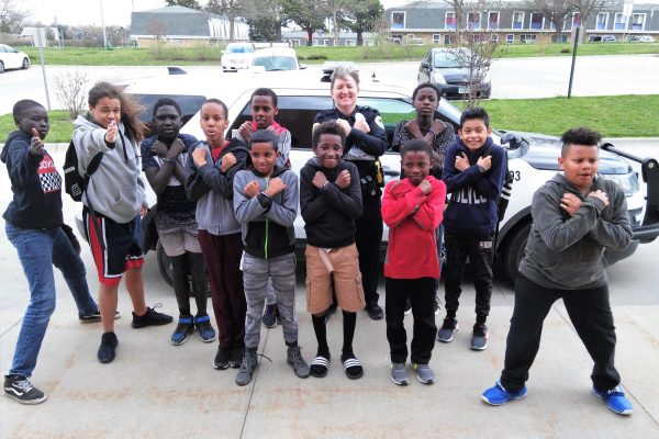 Boys To Men group learns about policing